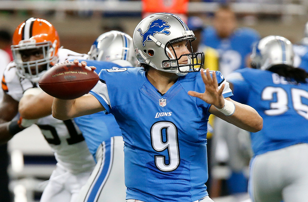 . Detroit Lions quarterback Matthew Stafford (9) throws against the Cleveland Browns in the first half of a preseason NFL football game at Ford Field in Detroit, Saturday, Aug. 9, 2014.  (AP Photo/Duane Burleson)