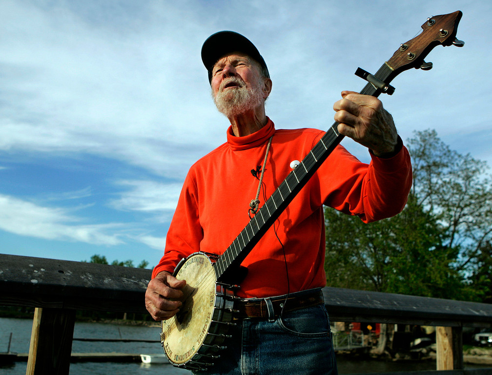 ". Pete Seeger plays his banjo Friday May 5, 2006 in Beacon, N.Y. The earnest troubadour who either co-wrote or popularized canonical songs like ""If I Had a Hammer\"" and \""John Henry\"" has become something like America\'s folkie emeritus.   (AP Photo/Frank Franklin II)"