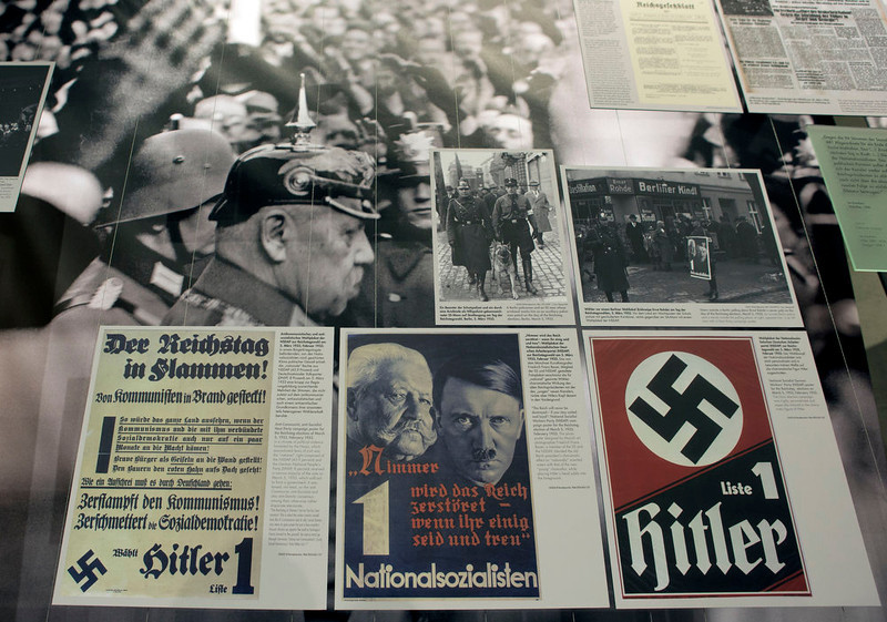. A poster, front center, showing Adolf Hitler, right, and Reich Chancellor Paul von Hindenburg, left, is pictured at the \'Berlin 1933 - the way to despotism\' exhibition at the Topography of Terror museum in Berlin, Germany, Wednesday, Jan. 30, 2013. The Topography of Terror museum is located at the area where the headquarters of the Gestapo and SS were destroyed by allied bombing. (AP Photo/Michael Sohn)