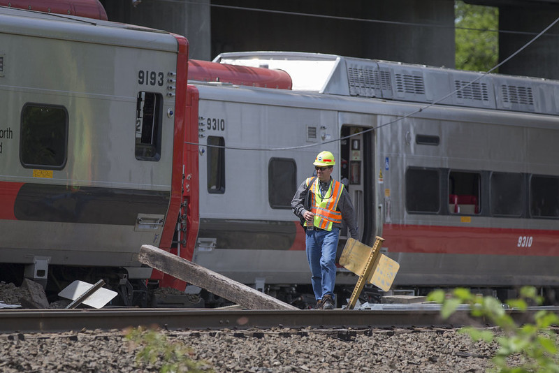 . A Connecticut state investigator examines the scene of a Metro North train collision on May 18, 2013 in Fairfield, Connecticut. Two New Haven Line Metro North commuter trains collided on Friday, May 17 near Bridgeport, CT, injuring as many as 70 people.  (Photo by Michael Graae/Getty Images)
