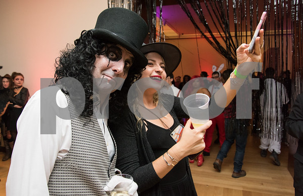 10/27/17 Wesley Bunnell | Staff The New Britain Museum of American Art held their Museum After Dark 11th Annual Halloween Bash on Friday evening. A guess stops to take a selfie with Alice Cooper aka Allan Weoby.