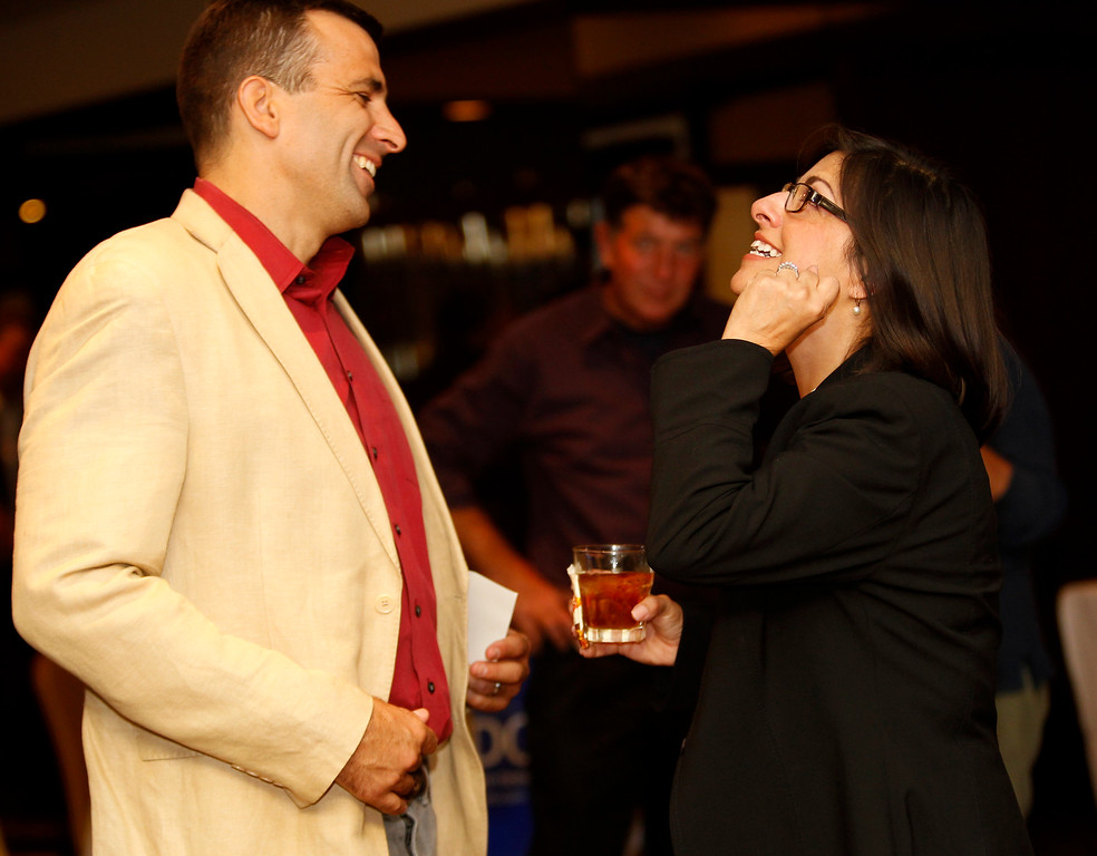 . San José City Council  Sam Liccardo converses with Santa Clara County Board of Supervisors candidate Teresa Alvarado as they waiting for final results at Flames Restaurant in downtown San Jose, Calif. Tuesday, July 30, 2013. ( Josie Lepe/Bay Area News Group)