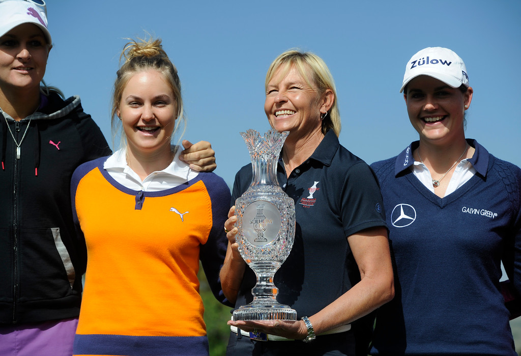 . From left to right, 2013 Solheim Cup European players, Anna Nordqvist, Charley Hull, European captain, Liselotte Neumann,  and golfer, Caroline Masson, pose for group pictures as Captain Liselotte Neumann, holds the Soleheim Cup at the Colorado Golf Club on media day in Parker Colorado, June 02, 2013. (Photo By Andy Cross/The Denver Post)