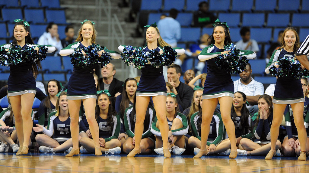 . Chino Hills cheerleaders at Citizens Business Bank Arena in Ontario, CA on Saturday, March 22, 2014. Chino Hills vs Centennial in the CIF boys Div 1 regional final. 2nd half. Centennial won 80-73 in overtime, Photo by Scott Varley, Daily Breeze)