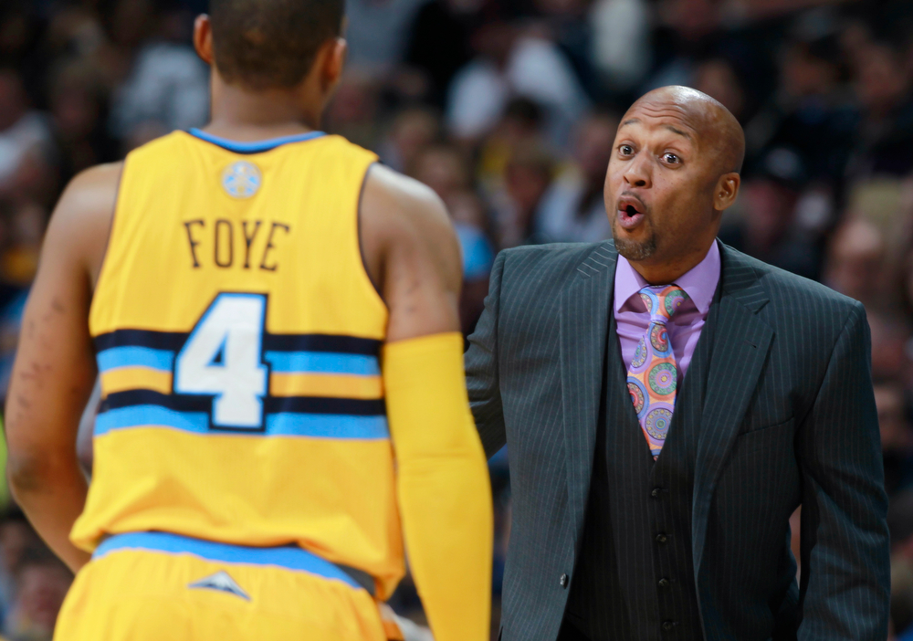 . Denver Nuggets head coach Brian Shaw, right, makes a point to guard Randy Foye while facing the Utah Jazz in the fourth quarter of the Nuggets\' 101-94 victory in an NBA basketball game in Denver on Saturday, April 12, 2014. (AP Photo/David Zalubowski)