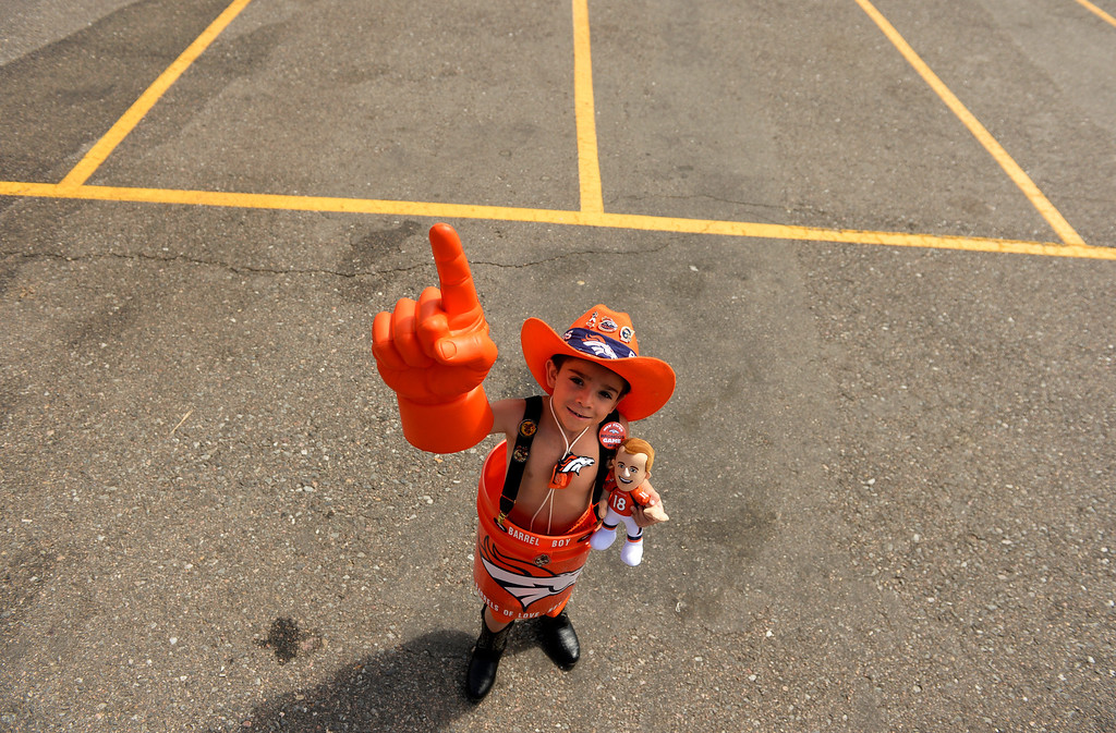 . DENVER, CO-September, 2013: Robert Valdez, 6, in the parking lot outside Sports Authority Field at Mile High in Denver, is ready for the game, September 05, 2013. The Denver area is buzzing as the Denver Broncos get ready to open the NFL season. (Photo By RJ Sangosti/The Denver Post)