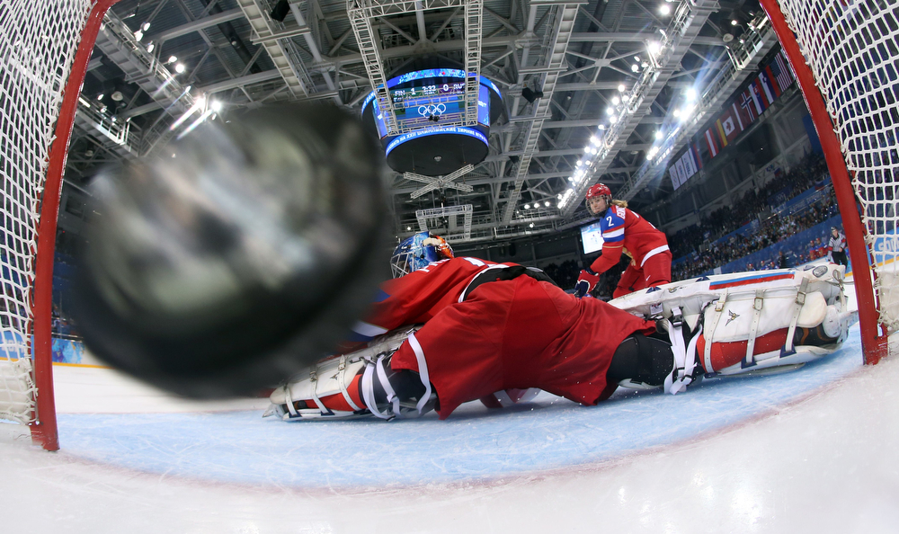 . Russia\'s goalkeeper Anna Prugova dives in vain as Finland\'s scores its second goal during the Women\'s Ice Hockey Classifications match between Finland and Russia at the Shayba Arena during the Sochi Winter Olympics on February 18, 2014. (Martin Rose/AFP/Getty Images)