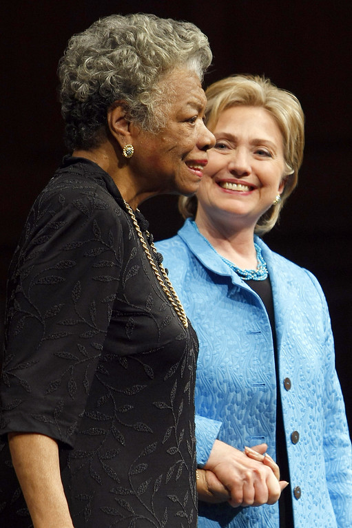 . In this April 18, 2008 file photo, Democratic presidential hopeful Hillary Rodham Clinton (R) holds the hand of Dr. Maya Angelou during a conversation in front of an audience at Wake Forest University in Winston-Salem, NC during a campaign stop. Award-winning author, renowned poet and civil rights activist Dr. Maya Angelou has died. She was 86. AFP PHOTO / ROBYN BECK /AFP/Getty Images