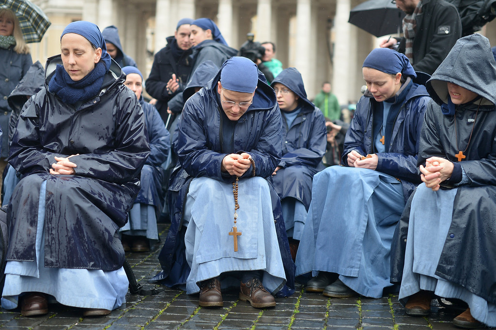 . Nuns pray on St Peter\'s square on the second day of the conclave on March 13, 2013 at the Vatican.   AFP PHOTO / GABRIEL BOUYS/AFP/Getty Images