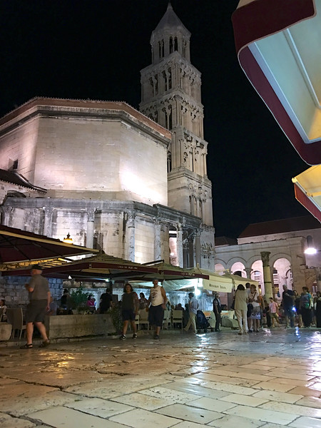 The octagonal building on the left was originally the Mausoleum of Diocletian, became the Cathedral of Saint Domnius in the 7th century. Bell Tower was constructed in 1100, extensively renovated in 1908. — at Diocletian's Palace.