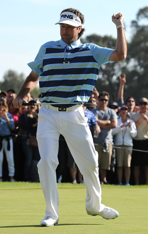 . Bubba Watson celebrates after making a birdie put on the 18th hole to finish 15 shots under par to win the 2014 Northern Trust Open. Pacific Palisades, CA. February 13, 2014 (Photo by John McCoy / Los Angeles Daily News)