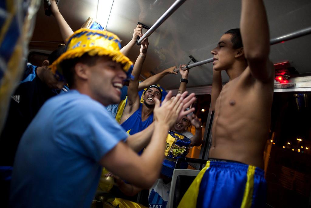 ". Members of the murga \""Los amantes de La Boca\"" have fun on a bus as they head to carnival celebrations in Buenos Aires, Argentina, Saturday, Feb. 2, 2013.  (AP Photo/Natacha Pisarenko)"