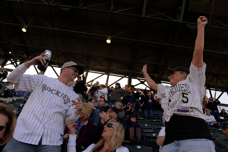 . Dillon Estep (Left) and Katie  Bennington (Right), both of Denver, react to a home run in the fourth inning of the Colorado Rockies home opener against the Arizona Diamondbacks at Coors Field in Denver, CO April 04, 2014. (Photo By Craig F. Walker / The Denver Post)