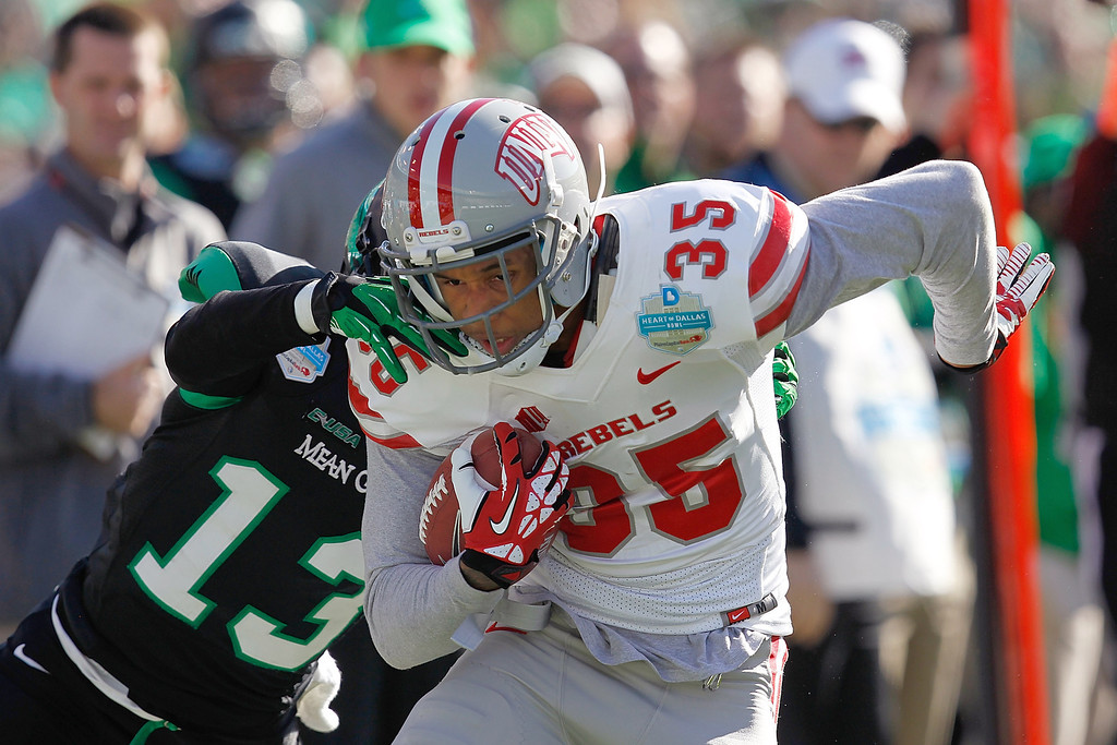 . DALLAS, TX - JANUARY 01:  Tim Cornett #35 of the UNLV Rebels runs against the North Texas Mean Green during the Heart of Dallas Bowl at Cotton Bowl Stadium on January 1, 2014 in Dallas, Texas.  (Photo by Sarah Glenn/Getty Images)