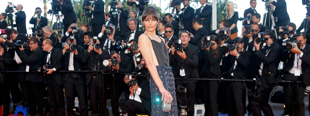 ". Actress Milla Jovovich poses on the red carpet as she arrives for the screening of the film ""Behind the Candelabra\"" in competition during the 66th Cannes Film Festival in Cannes May 21, 2013.              REUTERS/Jean-Paul Pelissier"