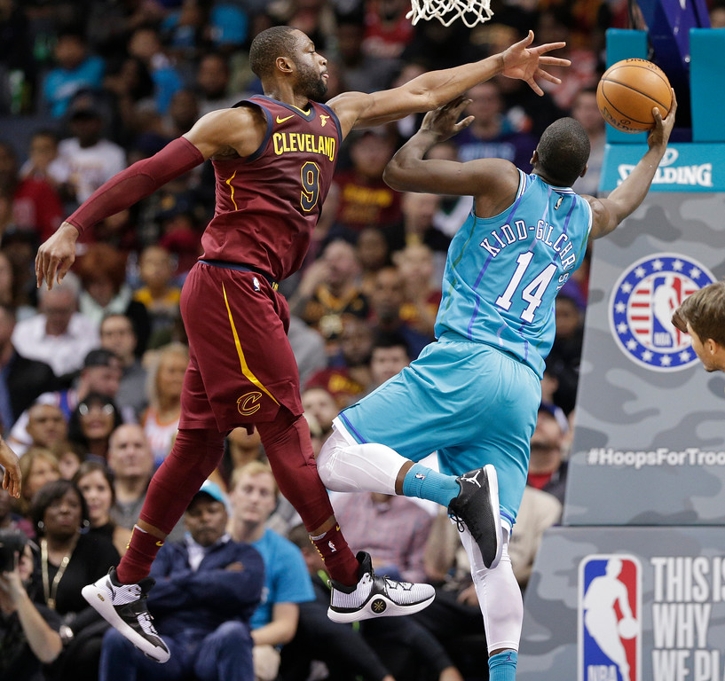 . Charlotte Hornets\' Michael Kidd-Gilchrist (14) drives past Cleveland Cavaliers\' Dwyane Wade (9) during the second half of an NBA basketball game in Charlotte, N.C., Wednesday, Nov. 15, 2017. (AP Photo/Chuck Burton)
