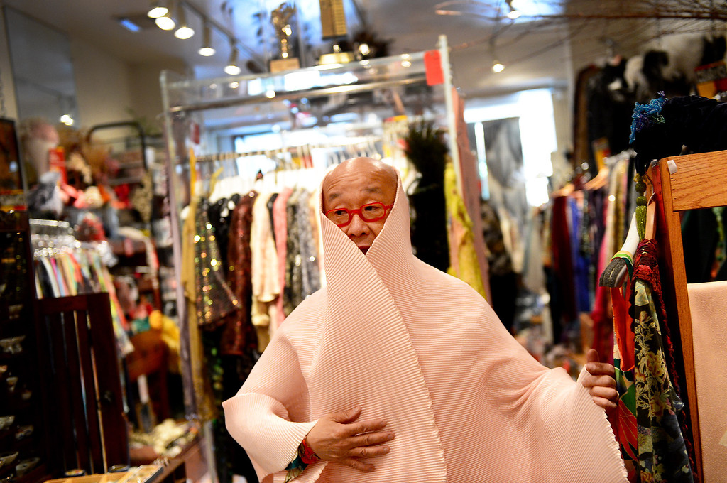 . Designer Peter Lai shows off a shawl he designed Thursday, June 20, 2013 at his San Marino boutique. Lai is retiring and closing his boutique after 20 years in San Marino. In retirement he plans to continue to perform Kabuki and open a Japanese village in downtown Los Angeles. (SGVN/Staff Photo by Sarah Reingewirtz)
