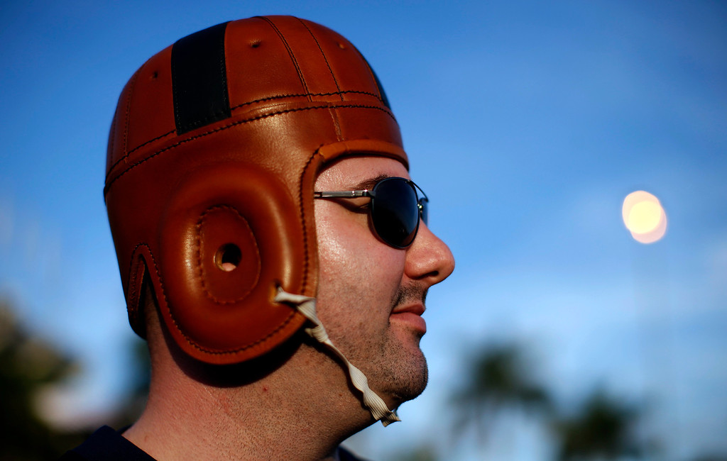 . A Notre Dame Fighting Irish fan dressed in a vintage football helmet stands outside Sun Life stadium before the BCS National Championship college football game between the Alabama Crimson Tide and the Notre Dame Fighting Irish in Miami, Florida January 7, 2013. REUTERS/Mike Segar