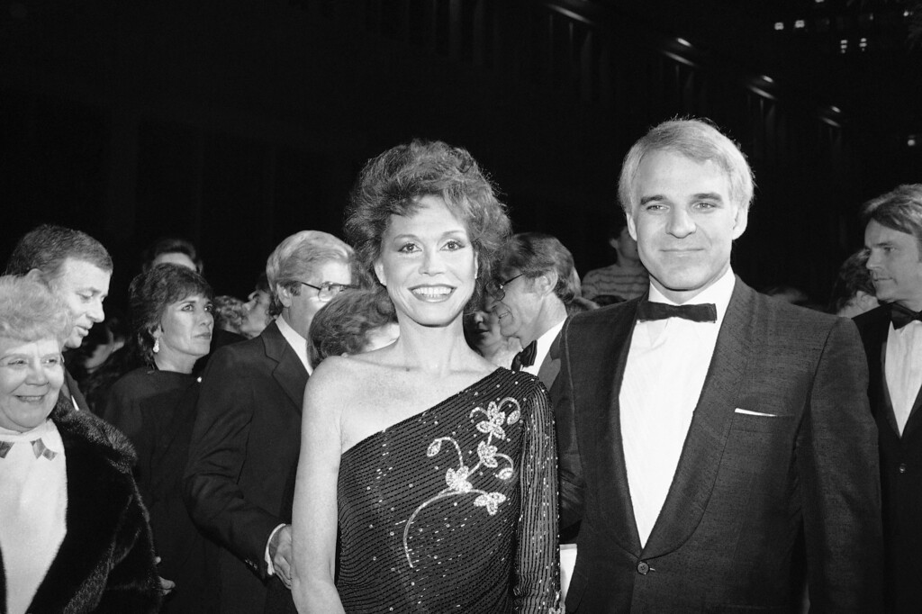 . Actress Mary Tyler Moore, one of the stars of the new film ?Six Weeks? from Universal, smiles as she arrives at the film?s charity premiere with guest Steve Martin, Monday, Dec. 7, 1982 in Los Angeles. Film also stars Dudley Moore. (AP Photo/Nick Ut)