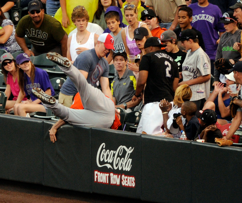 . Miami infielder Logan Morrison went into the first row of seats at Coors Field to make a catch and retire Rockies batter Michael Cuddyer in the sixth inning. The Colorado Rockies hosted the Miami Marlins at Coors Field Thursday afternoon, July 25, 2013. Photo By Karl Gehring/The Denver Post