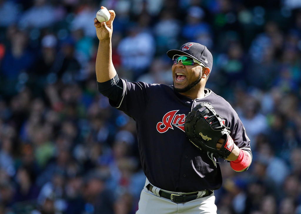 . Cleveland Indians first baseman Edwin Encarnacion holds up the ball after the throw from Indians left fielder Austin Jackson to him was on time to get out Seattle Mariners\' Kyle Seager for a double play as Seager tried to get back to first base on a fly-out hit by Mariners\' Yonder Alonso in the fourth inning of a baseball game, Sunday, Sept. 24, 2017, in Seattle. (AP Photo/Ted S. Warren)