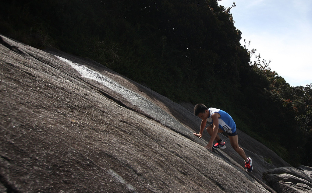. KUNDASANG, MALAYSIA - OCTOBER 19:  A participant runs through the gruelling course during the 2013 Mount Kinabalu Climbathon on October 19, 2013 in Kundasang, Sabah, Malaysia. The Climbathon, which first started in 1987, has now gained the International Skyrunning Federation accredititation that draws top international runners from various countries who race to gather points with the aim of becoming the series world champion.  (Photo by Rahman Roslan/Getty Images)