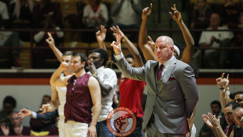 Buzz Williams holds up two fingers to signal a defensive call after the Hokies score a basket in the first half. (Mark Umansky/TheKeyPlay.com)