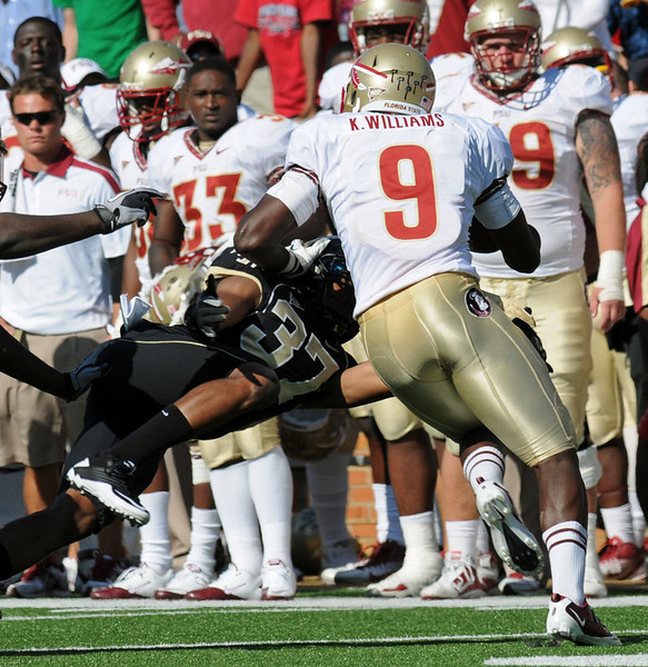 Morgan Harris tackles Karlos Williams.jpg