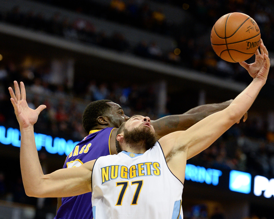. DENVER, CO - MARCH 02: Denver Nuggets center Joffrey Lauvergne (77) hauls down a rebound from Los Angeles Lakers forward Brandon Bass (2) March 2, 2016 at Pepsi Center. (Photo By John Leyba/The Denver Post)