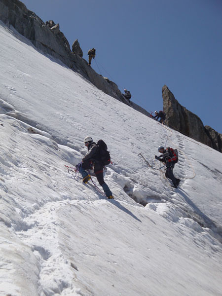 Most climbers sensibly ascend via the rocky ridge along the right edge of the ice face.