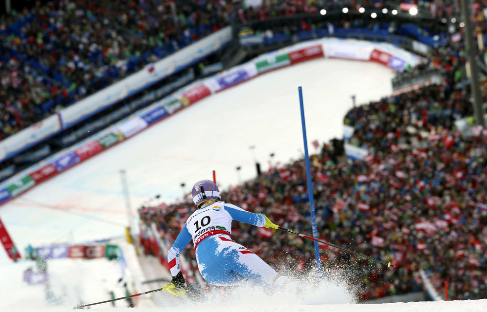. Austria\'s Michaela Kirchgasser clears a gate during the second run of the women\'s slalom, at the Alpine skiing world championships in Schladming, Austria, Saturday, Feb.16, 2013. (AP Photo/Alessandro Trovati)