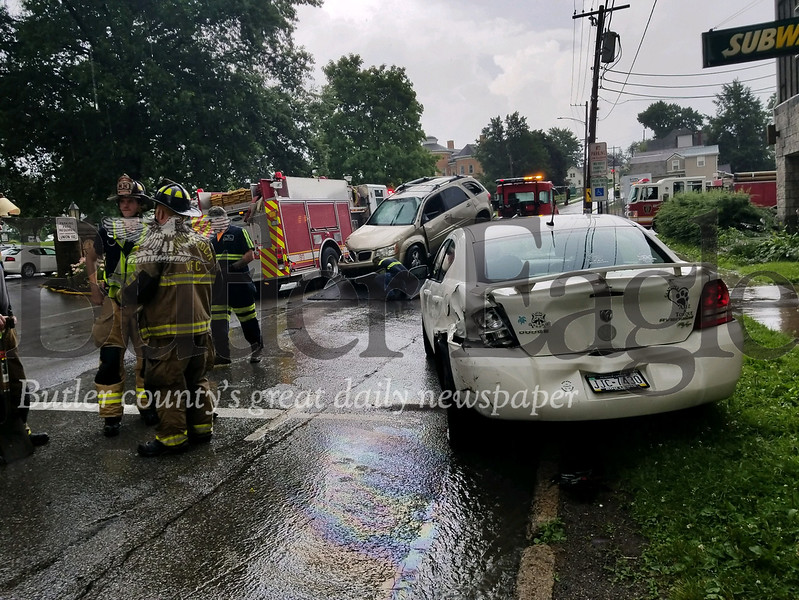 A crash today on Slippery Rock's Main Street sent three people, including one child, to the hospital.
