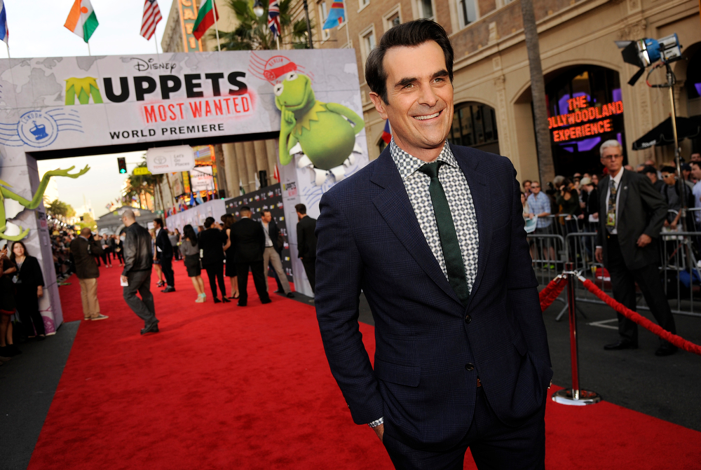 """. Ty Burrell, a cast member in \""""Muppets Most Wanted,\"""" poses at the premiere of the film on Tuesday, March 11, 2014, in Los Angeles. (Photo by Chris Pizzello/Invision/AP)"""