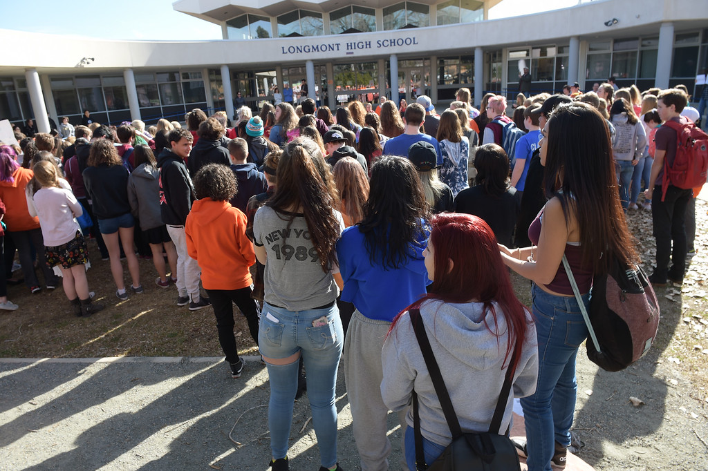 . Longmont High School students gather outside the main entrance Wednesday morning during National Walkout Day. To view more photos visit timescall.com. Lewis Geyer/Staff Photographer March 14, 2018