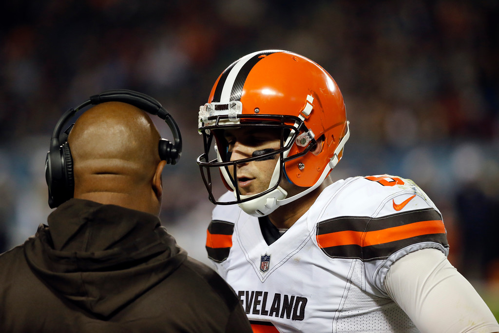 . Cleveland Browns quarterback Cody Kessler (6) talks to head coach Hue Jackson during the first half of an NFL preseason football game against the Chicago Bears, Thursday, Aug. 31, 2017, in Chicago. (AP Photo/Charles Rex Arbogast)