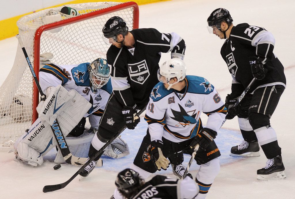 . The Kings\' Jeff Carter, left, shot is blocked by Sharks\' goalkeeper Antti Niemi and the rebound was put back by Dustin Penner, right, for the game-tying goal late in the third period. (Michael Owen Baker/Staff Photographer)