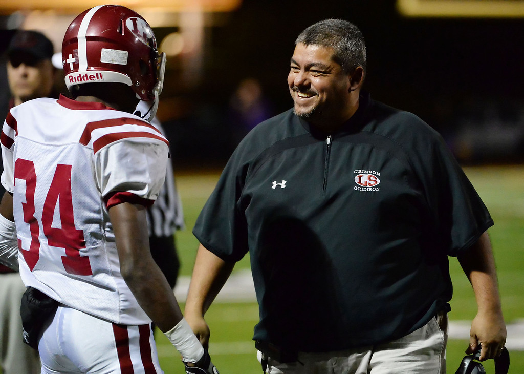 . La Serna head coach Margarito Beltran smiles after a touchdown in the first half of a CIF-SS playoff football game against Diamond Bar at Diamond Bar High School in Diamond Bar, Calif., on Friday, Nov. 22, 2013.   (Keith Birmingham Pasadena Star-News)