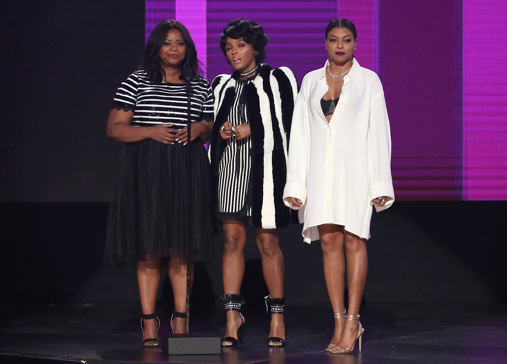 . Octavia Spencer, from left, Janelle Monae and Taraji P. Henson present the award for favorite duo or group - pop/rock at the American Music Awards at the Microsoft Theater on Sunday, Nov. 20, 2016, in Los Angeles. (Photo by Matt Sayles/Invision/AP)