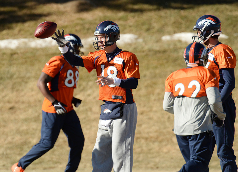 . Denver Broncos QB Peyton Manning (18) is warming up for the team practice at Dove Valley. Centennial Colorado. January 17. 2014. (Photo by Hyoung Chang/The Denver Post)