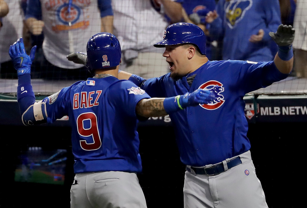. Chicago Cubs\' Javier Baez celebrates his home run against the Cleveland Indians with Kyle Schwarber during the fifth inning of Game 7 of the Major League Baseball World Series Wednesday, Nov. 2, 2016, in Cleveland. (AP Photo/Matt Slocum)