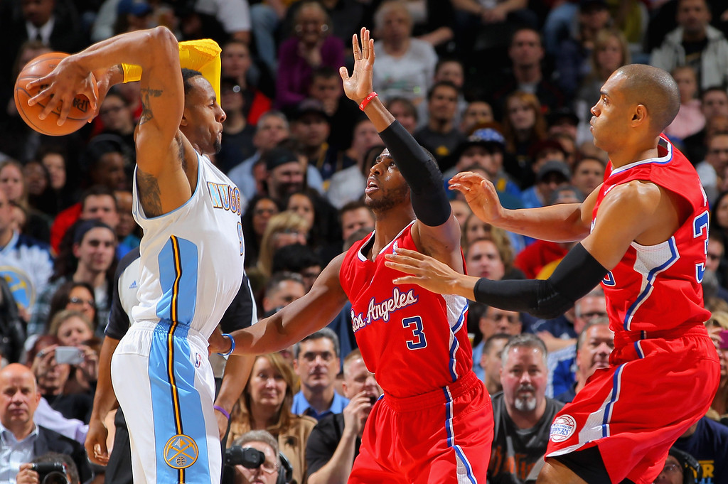 . DENVER, CO - MARCH 07:  Andre Iguodala #9 of the Denver Nuggets controls the ball against Chris Paul #3 of the Los Angeles Clippers and Grant Hill #33 of the Los Angeles Clippers at the Pepsi Center on March 7, 2013 in Denver, Colorado.  (Photo by Doug Pensinger/Getty Images)