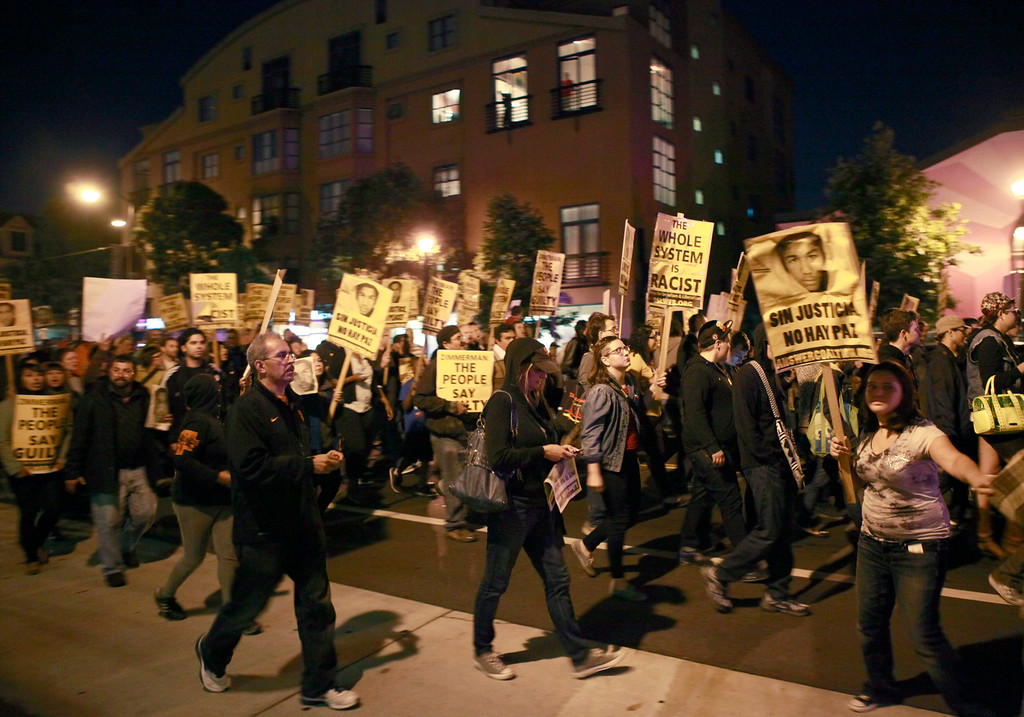. 200 people marched peacefully in San Francisco, Calif., Saturday night, July 13, 2013 protesting George Zimmerman\'s acquittal hours earlier in a Florida courtroom. The march lasted for two hours through the city\'s Mission District. (Karl Mondon/Bay Area News Group)