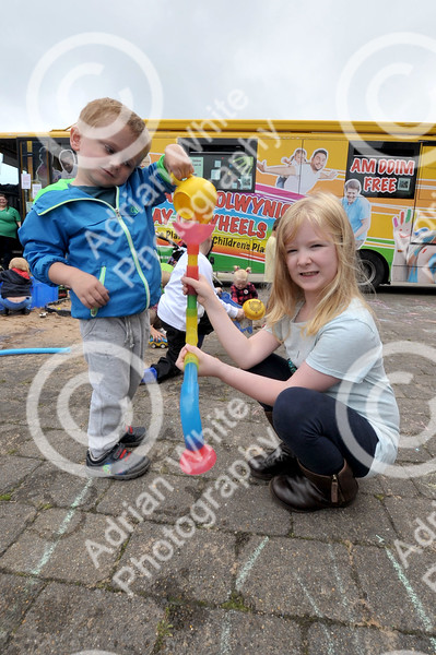 Young children had a ball celebrating National Playday at the National Waterfront Museum.. pictured ... Lucas Gosney aged 3 and sister Freya aged 6 having fun outside the playbus.  Swansea Council organised the event which was also a celebration of the 20th anniversary of the authority having a play team. Activities at the event included the Play on Wheels Playbus, Interplay Pirate Ship, Circus Eruption, Park Lives and the chance to take part in some old fashioned games.