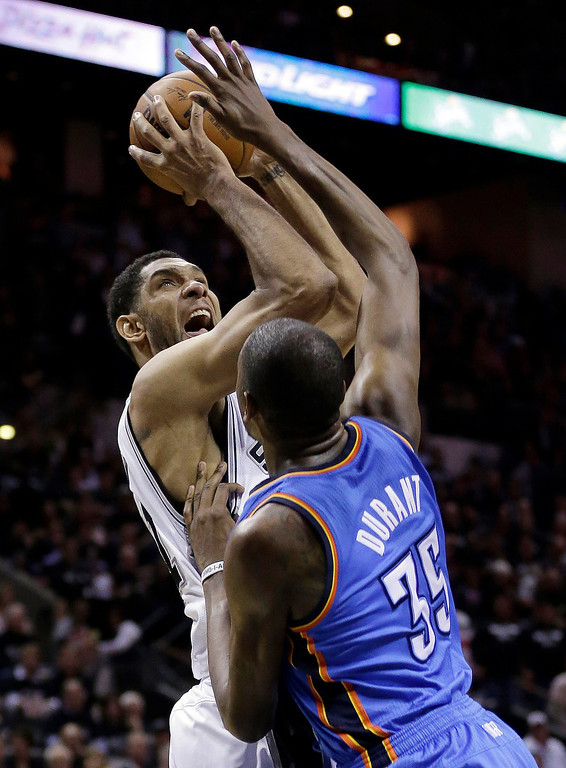 . San Antonio Spurs\' Tim Duncan, left, shoots over Oklahoma City Thunder\'s Kevin Durant (35) during the first half of Game 1 of a Western Conference finals NBA basketball playoff series, Monday, May 19, 2014, in San Antonio. (AP Photo/Eric Gay)