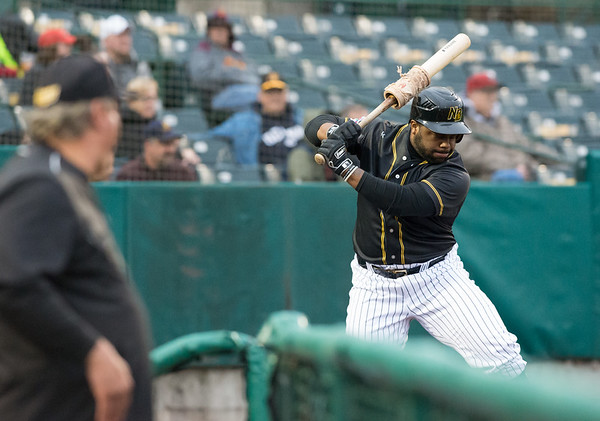 05/03/19 Wesley Bunnell | Staff The New Britain Bees home opener vs the Somerset Patriots on Friday night at New Britain Stadium. First baseman Jason Rogers (9) takes a practice swing in the on deck circle.