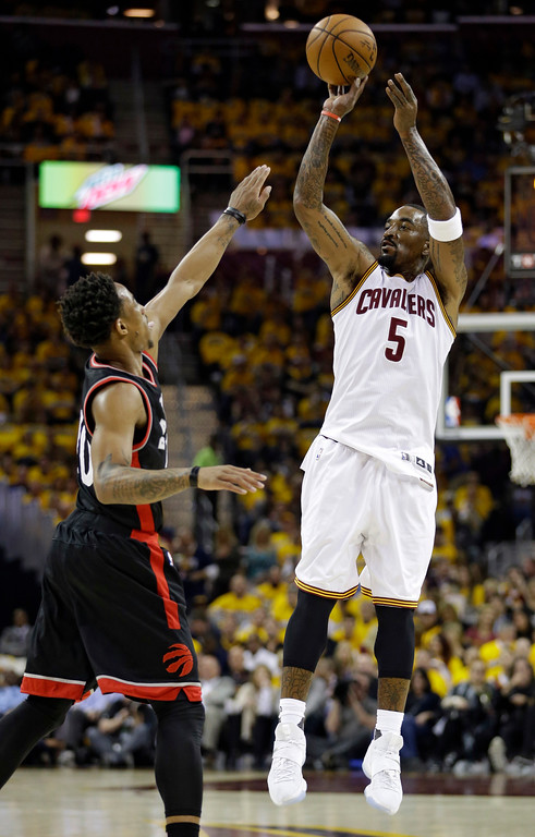 . Cleveland Cavaliers\' J.R. Smith (5) shoots over Toronto Raptors\' DeMar DeRozan (10) in the first half in Game 1 of a second-round NBA basketball playoff series, Monday, May 1, 2017, in Cleveland. The Cavaliers won 116-105. (AP Photo/Tony Dejak)