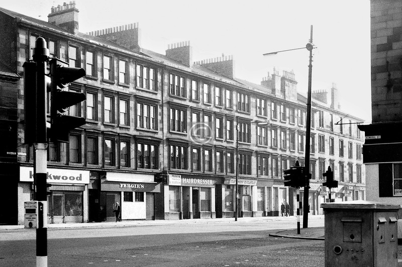 Paisley Rd, north side from Admiral St.   'Fergie's' was an early business venture by the future Sir Alex, who at the time I took this photo was  with Ayr Utd and in the last weeks of his playing career.      April 1974