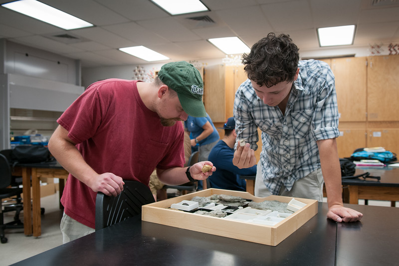 Chris Wadowsky (left) and Wesley Garcia working intensively in their Invertebrate Paleontology course.