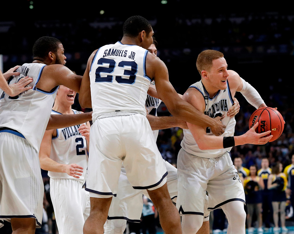 . Villanova\'s Donte DiVincenzo, right, celebrates with his teammates after the championship game of the Final Four NCAA college basketball tournament against Michigan, Monday, April 2, 2018, in San Antonio. Villanova won 79-62.(AP Photo/David J. Phillip)