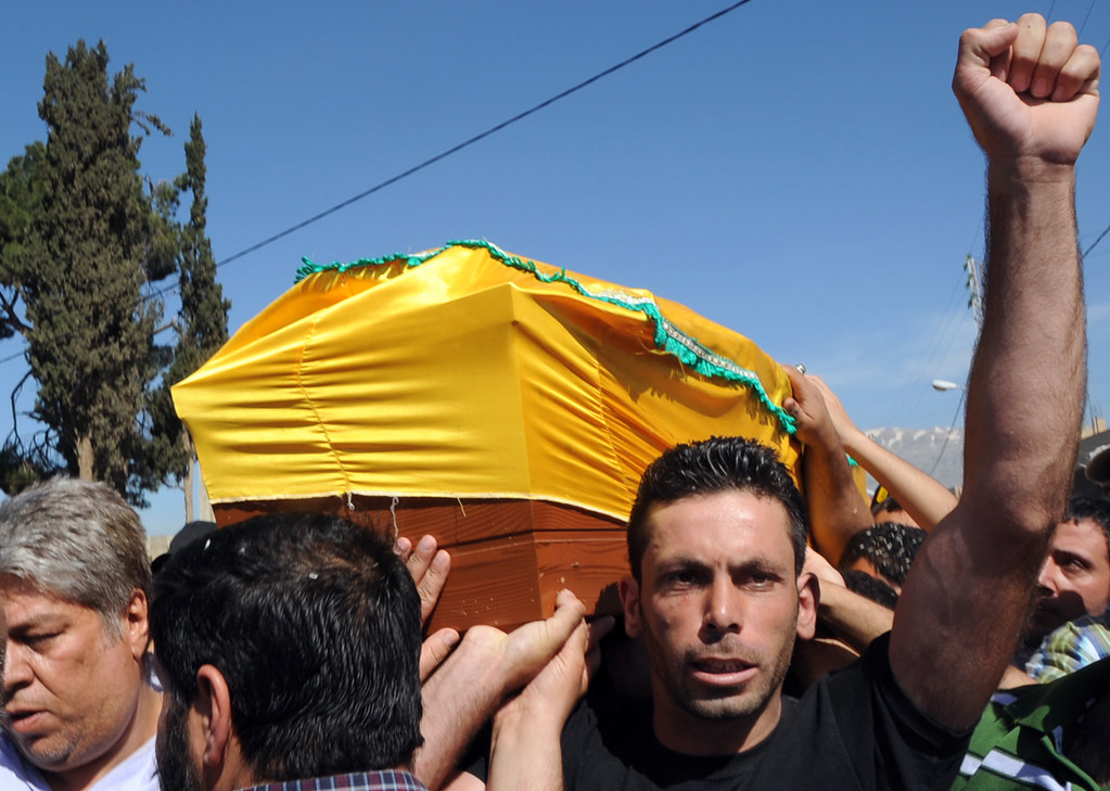 . Members of Lebanon\'s of Hezbollah Shiite Muslim movement carry the coffin of a killed comrade during his funeral in the village of Haret al-Fikani, in the Bekaa valley, on May 23, 2013, after being reportedly killed in the ongoing battle of Qusayr in the province of Homs, in neighboring Syria. Seventy-five fighters from Lebanon\'s Hezbollah have been killed in Syria since they first became involved in the country\'s war months ago, a source close to the Shiite militant group said. AFP PHOTO/STR-/AFP/Getty Images